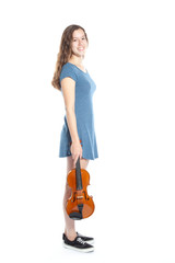 teenage girl in minidress stands with violin in studio
