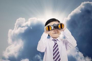 Close-up business boy holding binoculars outdoor