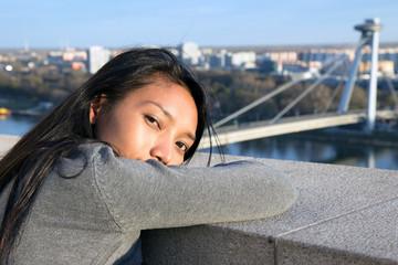 Asian woman do watch on SNP bridge in Bratislava