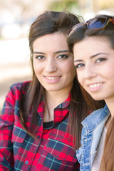Young girls smile to the camera