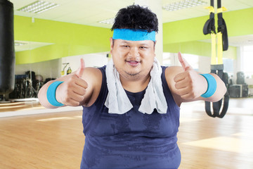 Fat man showing thumbs up