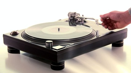 DJ Turntable. Dropping the needle on a spinning vinyl long-shot