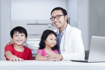 Friendly doctor with children