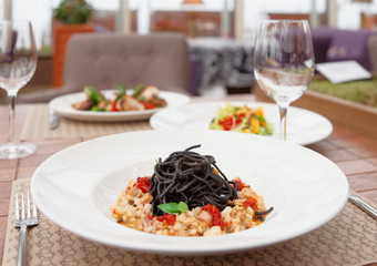 Black squid ink pasta with seafood and other dishes