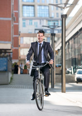 Man on a bicycle on modern city background