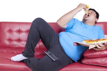 Overweight man eats pizza 1