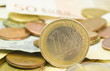 one euro coin , money background