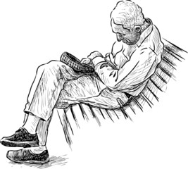 old man sleeping on a park bench