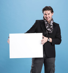 smiling handsome man with big blank board