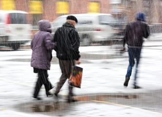 People walking in the street in a snowy winter day