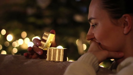 Amazed woman looking at magical christmas gift in the box