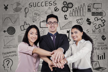 Successful businesspeople joining hands