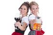 canvas print picture - Zwei Frauen im Dirndl mit Bier und Wein stoßen an