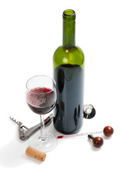 Red wine bottle, glasses, corkscrew, corks and thermometer.