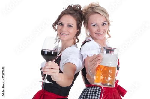 canvas print picture Zwei Frauen im Dirndl mit Bier und Wein stoßen an