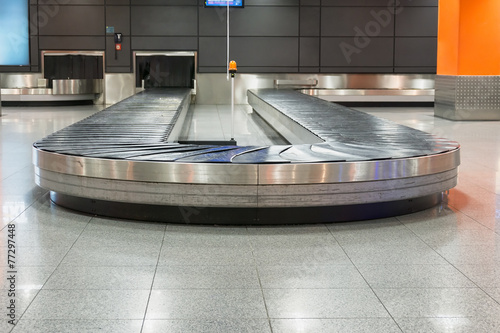 Empty baggage claim area in airport - 77297448