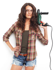 Image of smiling woman with drill over white wall