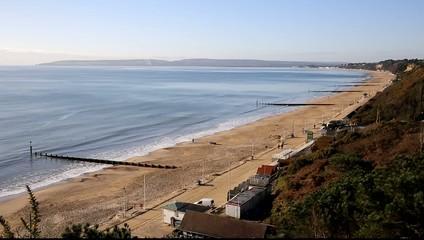 View west Bournemouth beach and coast Dorset England UK