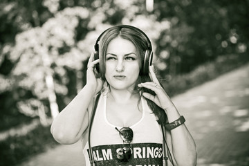 beautiful young girl listening to music on headphones