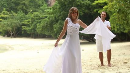 blonde bride swinging wings of wedding dress