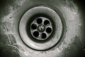 Drain hole in the kitchen sink close-up