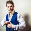 Elegant young handsome man in white shirt & vest.