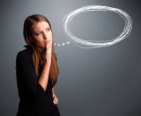 Young lady thinking about speech or thought bubble with copy spa