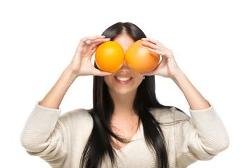 Young  woman with grapefruit  studio portrait