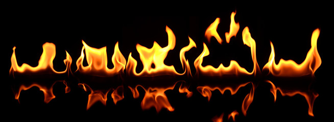 Beautiful fire flames reflected in black table