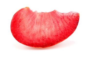 Colorful bright macro closeup slice of pluot apricot plum fruit
