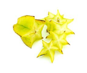 Beautiful setup of ripe vibrant starfruit slices isolated on whi