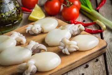 Raw babies cuttlefish  on a cutting board