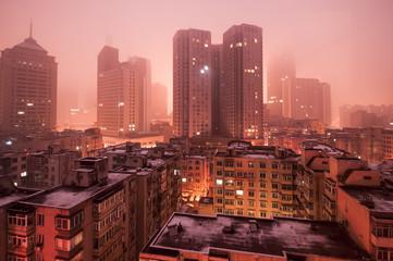 Scene of cites covered by fog.