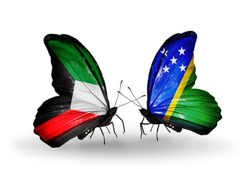 Two butterflies with flags Kuwait and Solomon Islands