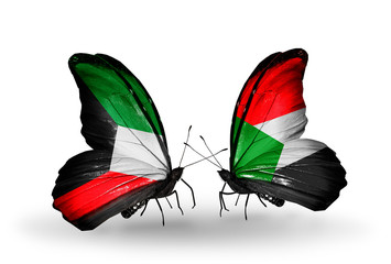 Two butterflies with flags Kuwait and Sudan