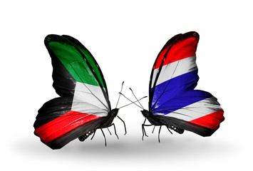 Two butterflies with flags Kuwait and Thailand