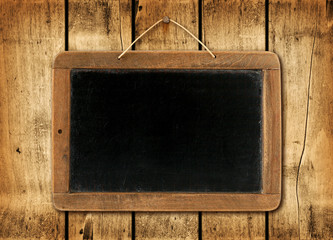 Blackboard on a wood wall background