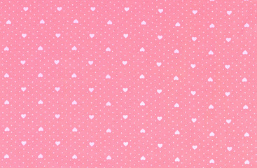 Hearts pattern on fabric texture background.