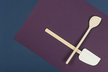 Wooden spatula and spoon on a blue napkin