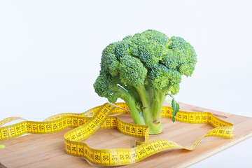 Broccoli with tape measure showing