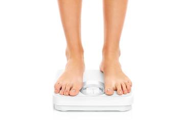 Woman feet on bathroom scales