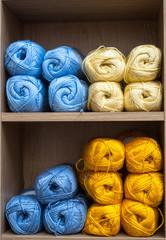 balls of knitting wool background