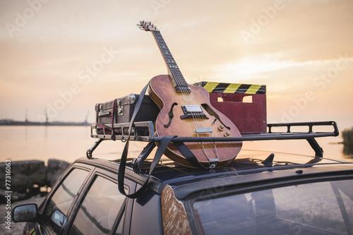 Leinwanddruck Bild Music instrumental guitar car outdoor background