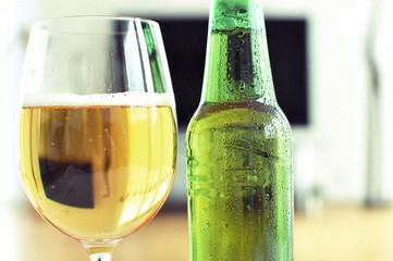 Glass of beer against TV-set