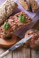 Sandwich with pate and basil close-up, vertical