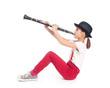 little girl playing clarinet on a white background - 77318016