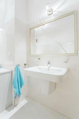 Blue towel in white toilet