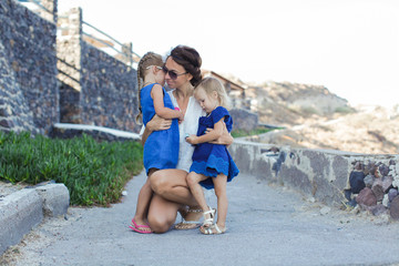 Mother and little girl in european vacation in greek town