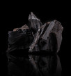 Leinwandbild Motiv Coal lumps on dark background