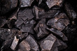 Coal lumps on dark background - 77320046